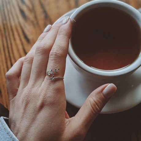 a-hand-over-a-cup-of-tea-2855098-min